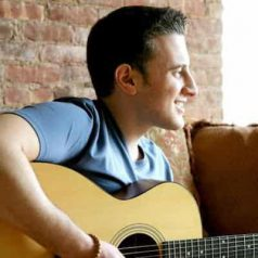 Singer-songwriter Michael Jayson playing the guitar
